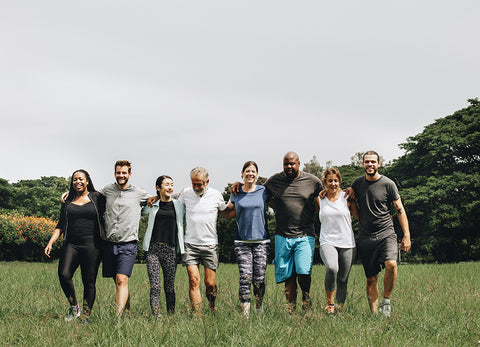 Group of people walking together in a field