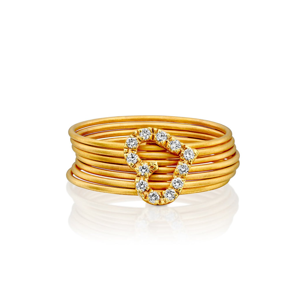 3720 - seven stackable band rings in 14kt yellow gold matte satin finish. connected to heart shape white diamond pave.