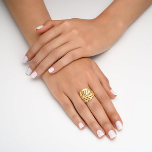 4735 - tropical palm leaf ring in 14kt hammered yellow gold, set with diamonds of the finest quality.