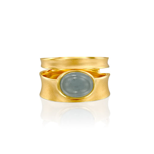4845A - striking 14kt yellow gold band ring with natural cabochon aquamarine oval shape. matte satin finish with shiny edges.