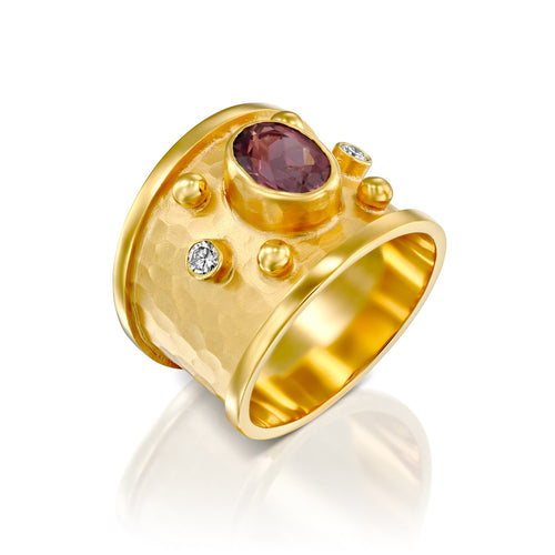 7300 - 14kt handmade matte finish yellow gold ring with shiny edges. rich color faceted pink tourmaline in a bezel setting, this ring has .10cttw white diamond of the finest quality.