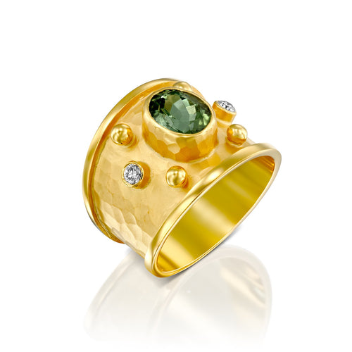 7300A - 14kt handmade matte finish yellow gold ring with shiny edges. rich color faceted green tourmaline in a bezel setting, this ring has .10cttw white diamond of the finest quality.