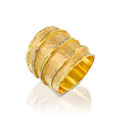7362 - 14kt yellow hammered gold ring, with three shiny gold rows set with .16cttw white diamonds.