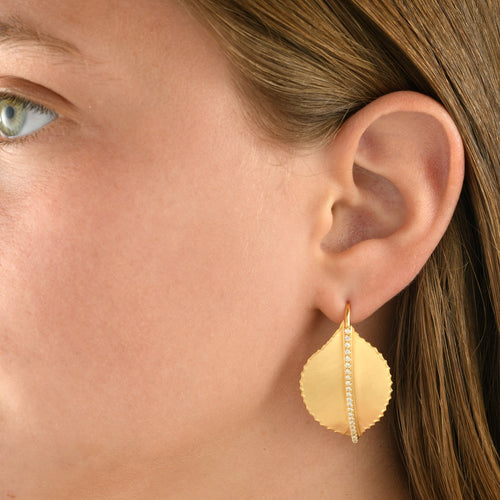 7368 - 14kt handmade detailed yellow gold leaf earring, unique matte finish with shiny torched edges and white diamonds on a short wire