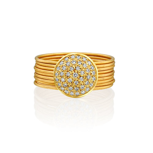 D5961A - nine stackable band rings in 14kt yellow gold matte satin finish, connected to a 10mm round white diamond pave disc.