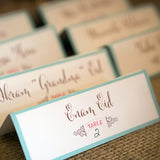 mint and coral escort cards