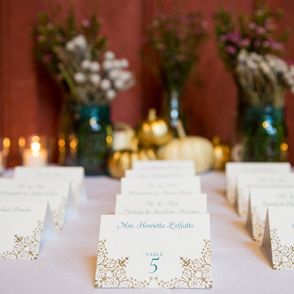 teal and gold wedding escort cards