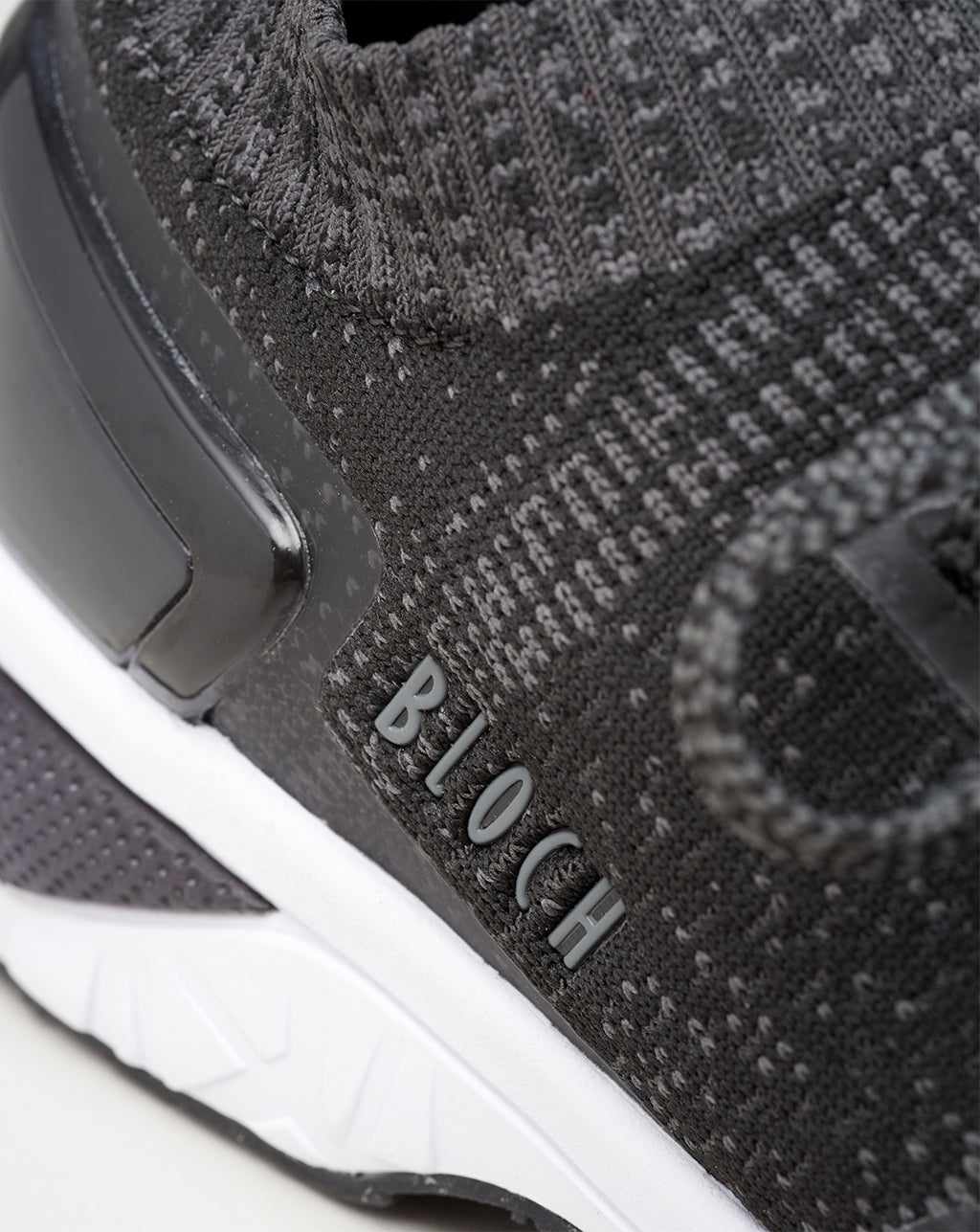 A close up of the side profile of the Alcyone in black highlighting the embossed BLOCH logo