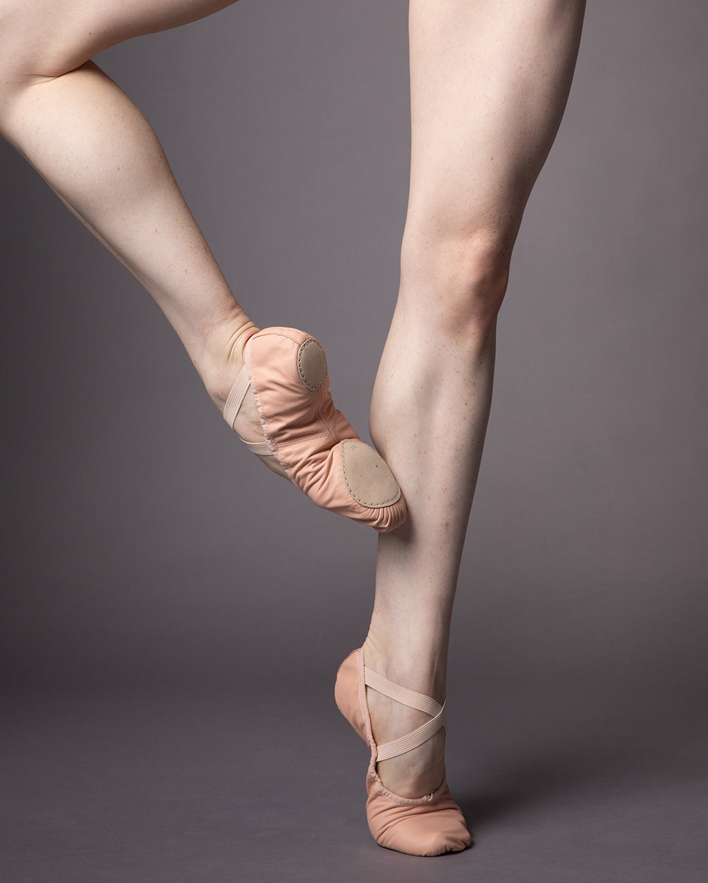 The legs of a ballet dancer wearing the Precision ballet shoes