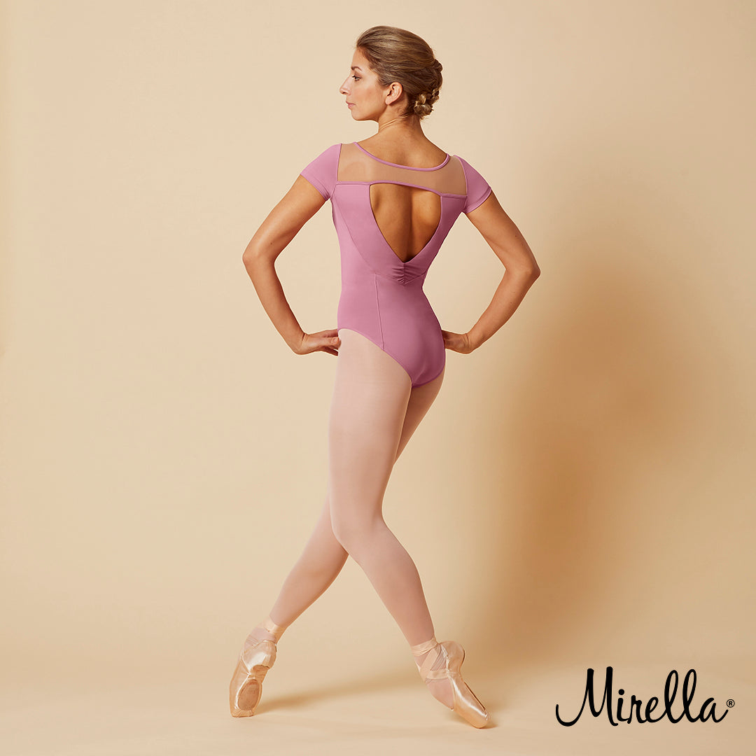 Ballet dancer Sasha Mukhamedov wearing the Mirella Jasmine Open Back Embroidered Mesh Cap Sleeve Leotard with pink tights