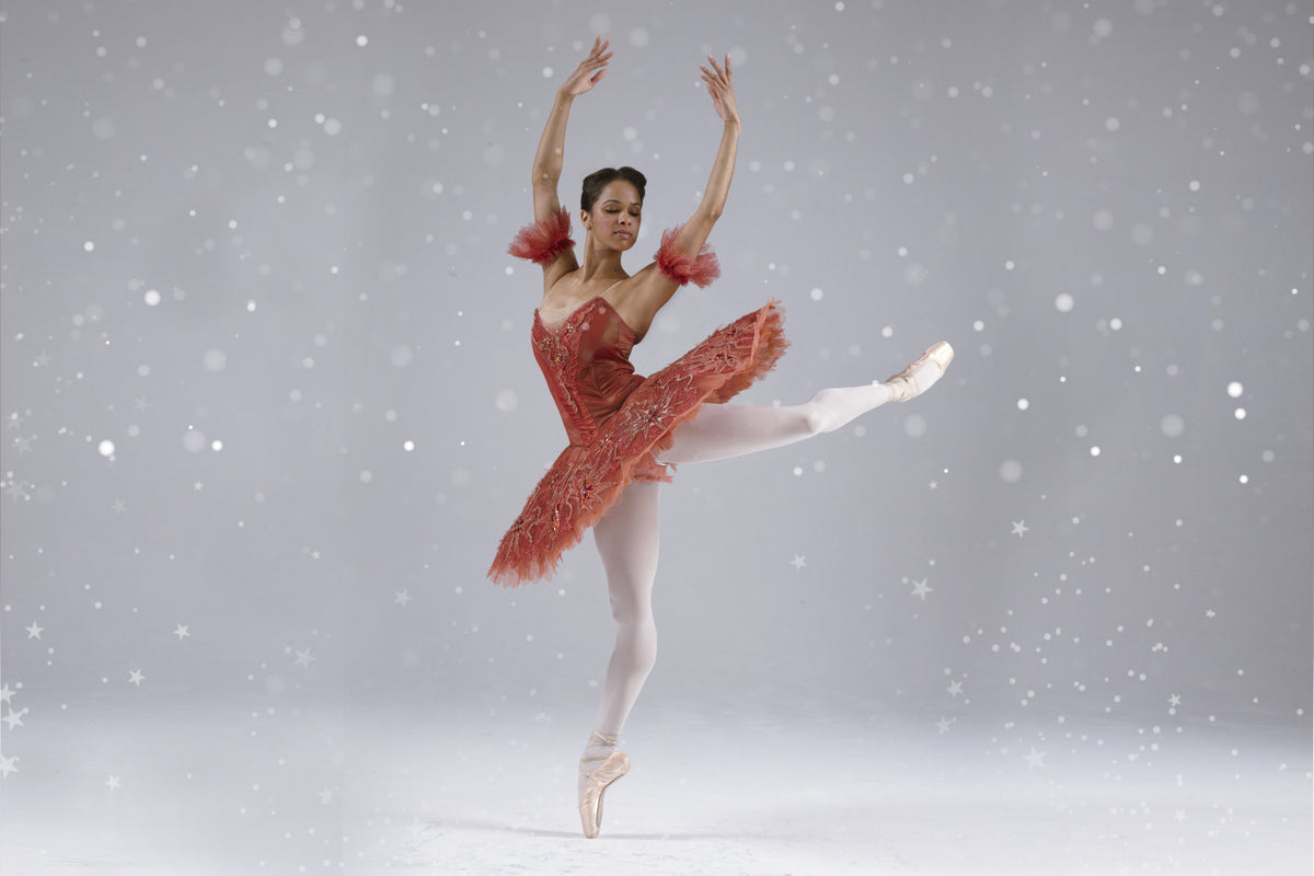 Ballerina Misty Copeland dancing en pointe wearing Nutcracker Christmas performance costume and pointe shoes