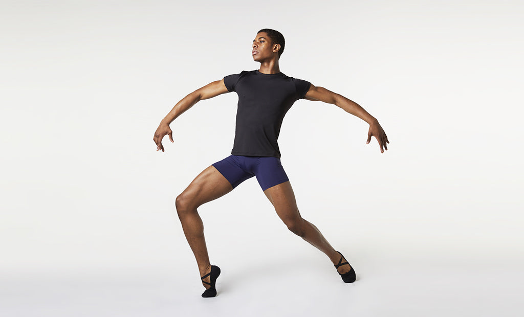 A male dancer practising his routine wearing BLOCH mens fitted t-shirt and short length rehearsal tights