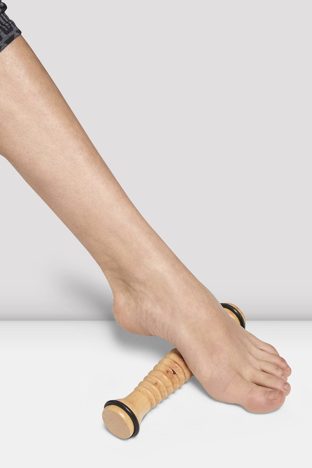 Wood Bloch Foot Roller used on foot