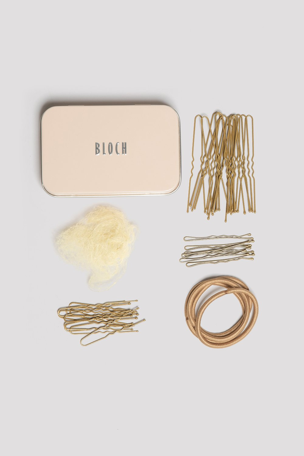 Blonde Bloch Hair Kit flatlay of pins, hairnet and elastics