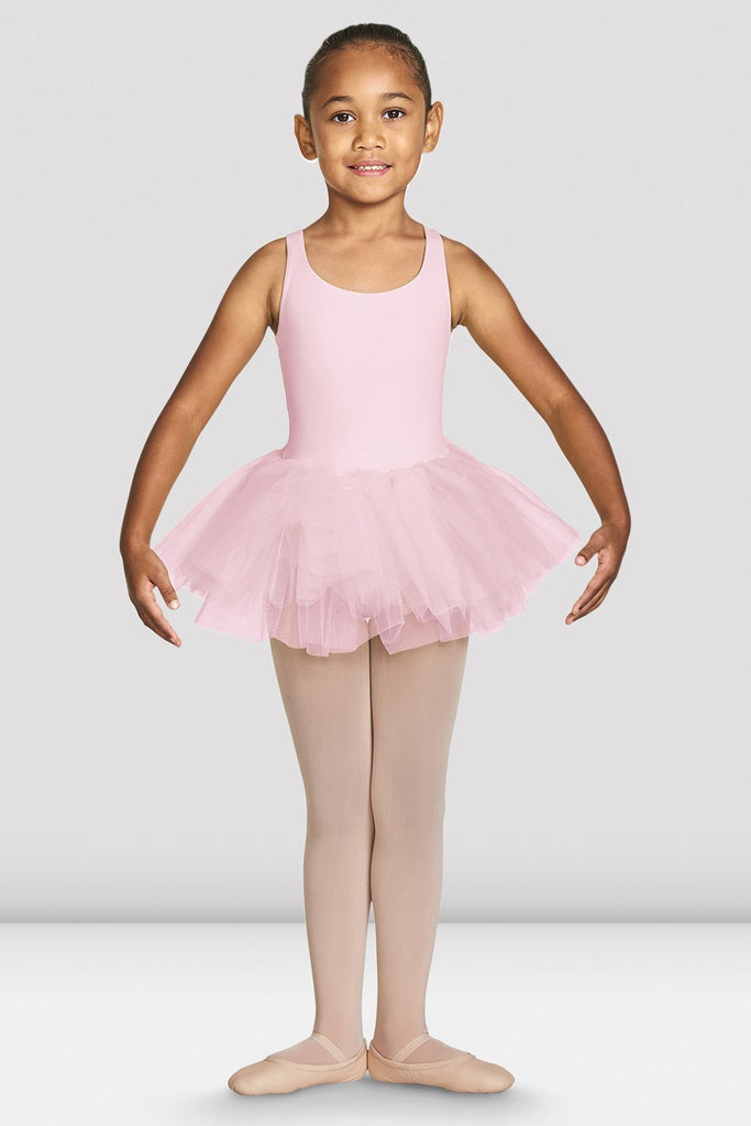 Candy pink Bloch Girls Clara Strap Tank Tutu Leotard on female model feet in first with arms in demi bra