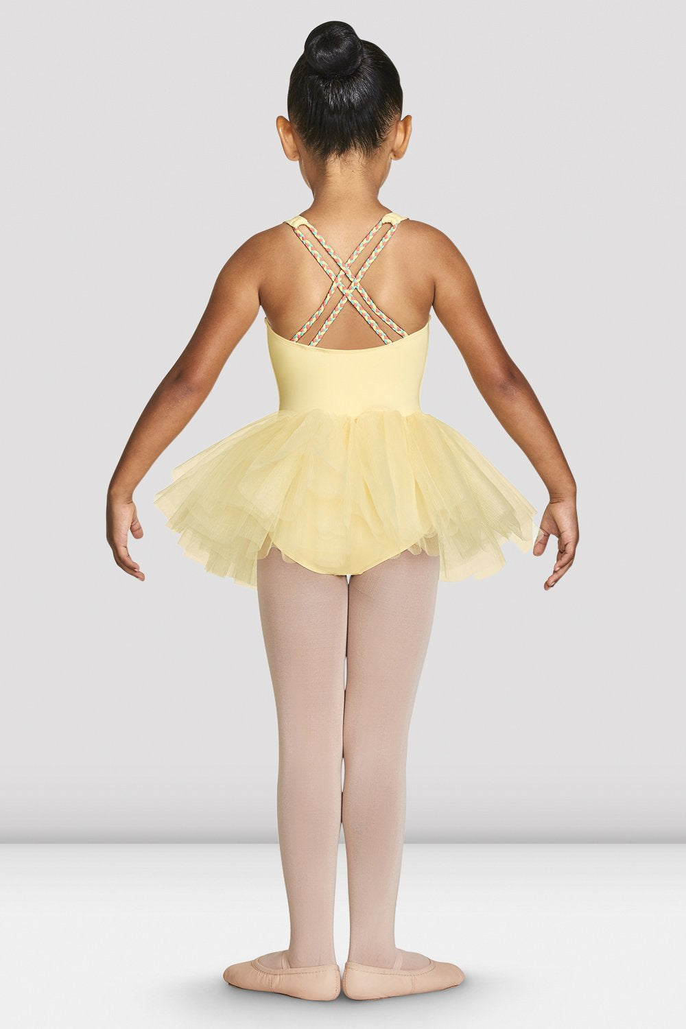 Sunshine Bloch Girls Clara Strap Tank Tutu Leotard on female model feet in first with arms in demi bra facing back