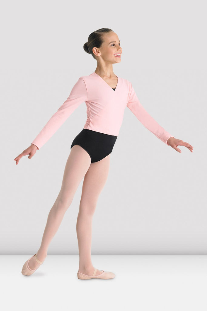 Pink Bloch Girls Cross Front Top on female model in second arabesque