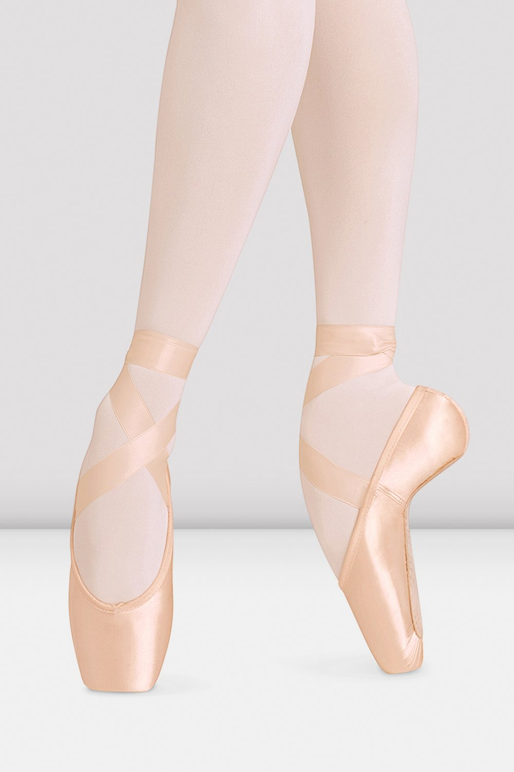 Pink satin Bloch European Balance Pointe Shoes on foot in fourth position en pointe