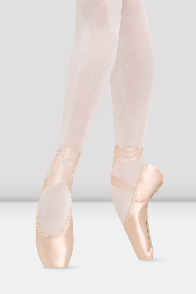 Pink satin Bloch TMT B-Morph Moldable Pointe Shoes on foot in fourth position en pointe