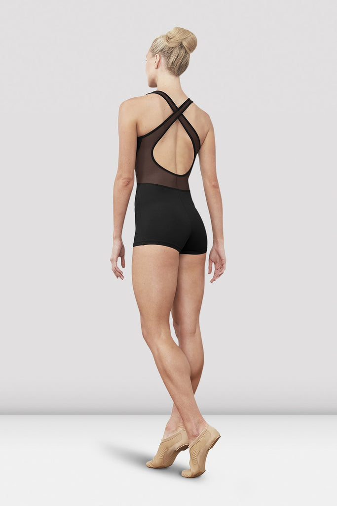 Black Bloch Ladies Ellora Zip Front Short Unitard on female model left foot on demi facing back corner