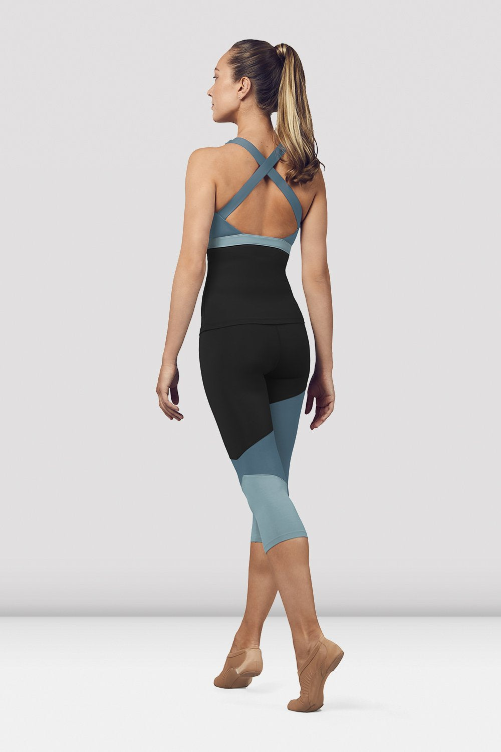 Seaport Bloch Ladies Color Panelled Capri Leggings on female model in parallel fourth position on releve facing back corner