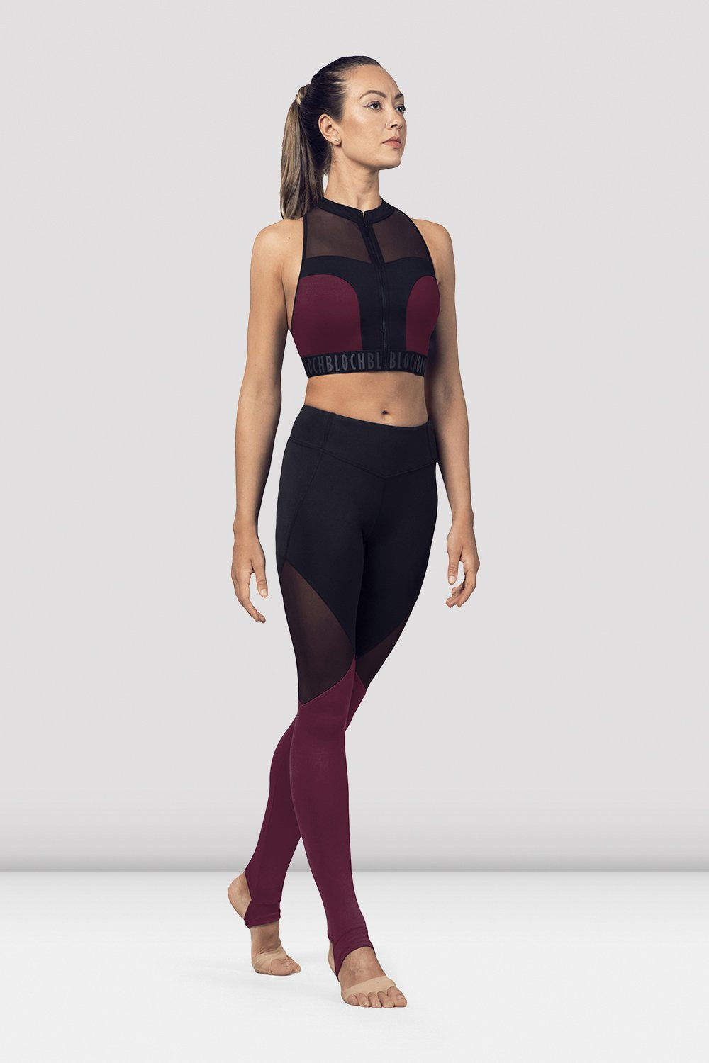 DewberryBloch Ladies Zip Front Mesh Back Crop Top on female model in parallel fourth position on releve facing corner