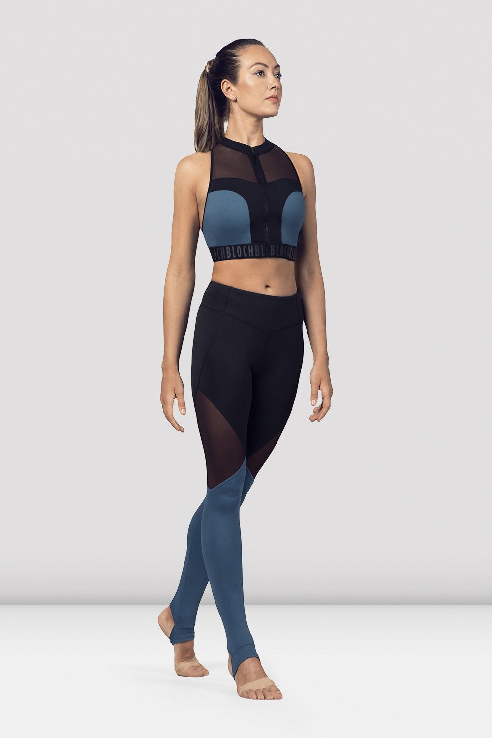 Seaport Bloch Ladies Zip Front Mesh Back Crop Top on female model in parallel fourth position on releve facing corner