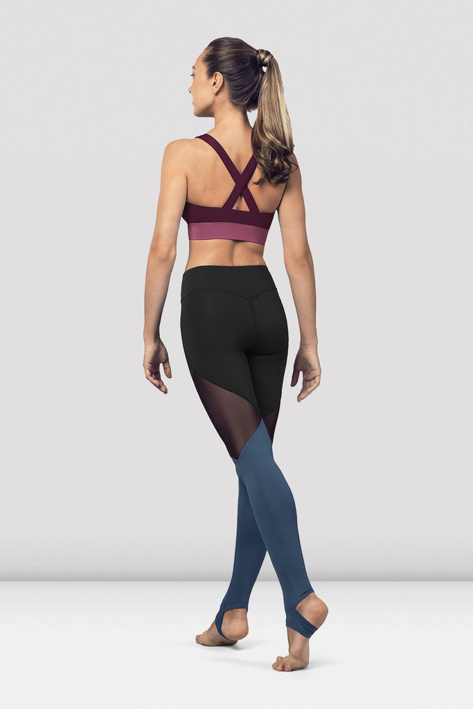 Dewberry Bloch Ladies Cross Back Tank Crop Top  on female model in parallel fourth position on releve facing back corner