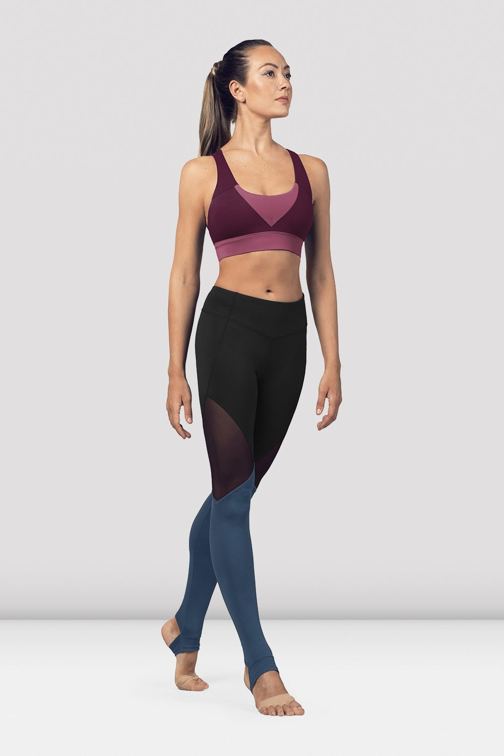 Dewberry Bloch Ladies Cross Back Tank Crop Top  on female model in parallel fourth position on releve facing corner
