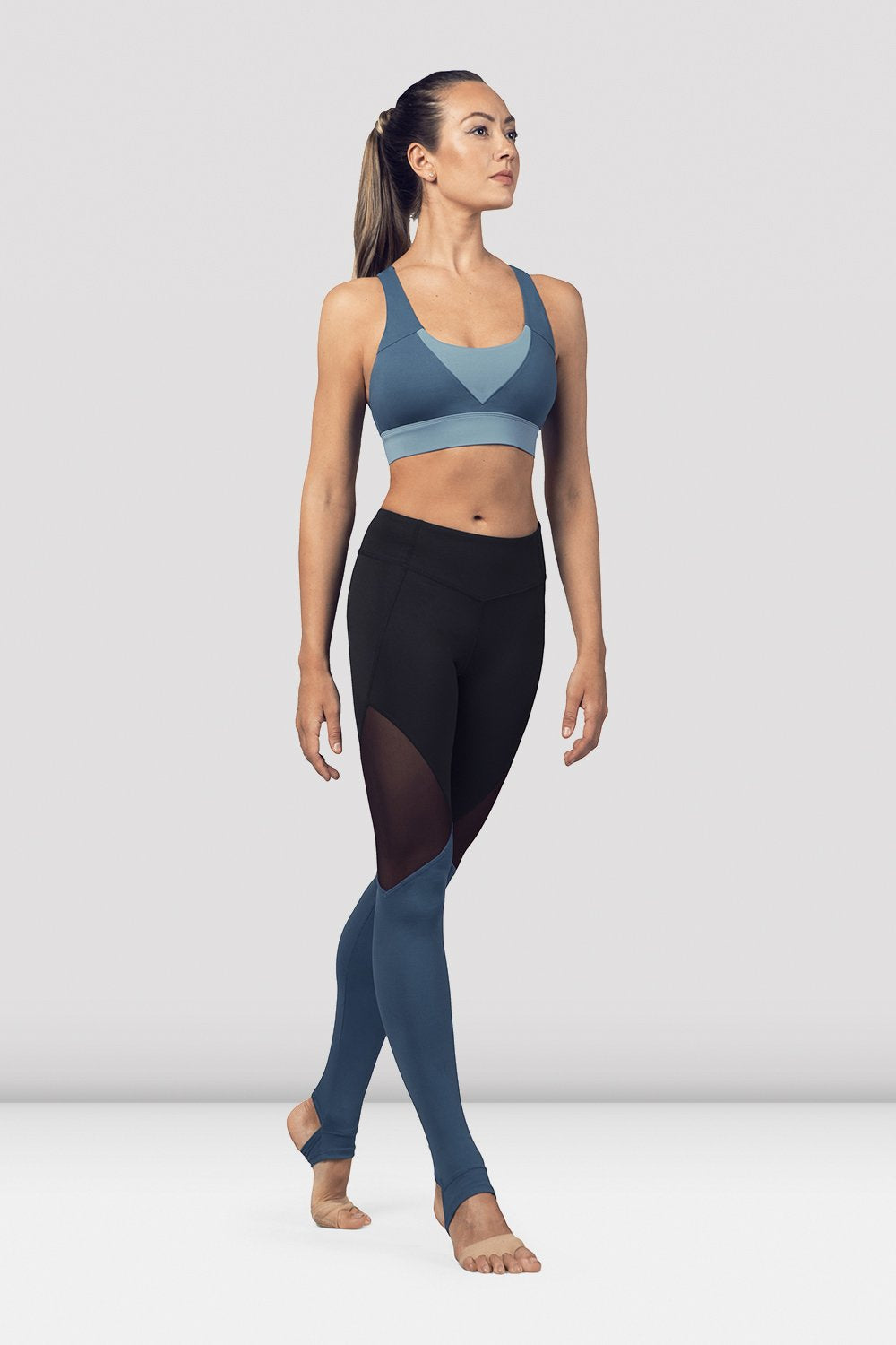 Seaport Bloch Ladies Cross Back Tank Crop Top  on female model in parallel fourth position on releve facing corner