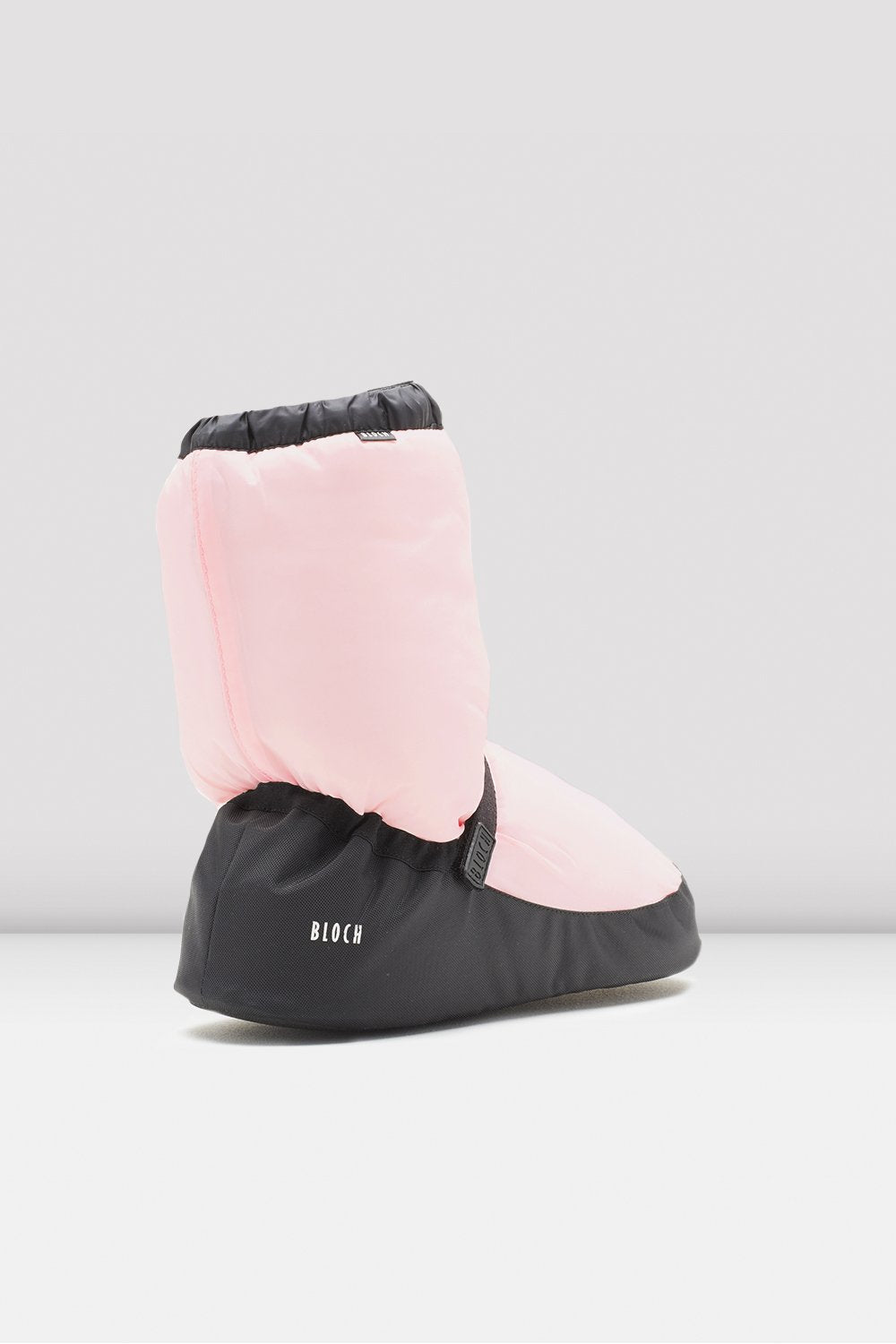 Candy pink nylon Bloch Adult Warm Up Booties single shoe side view focus on heel of shoe