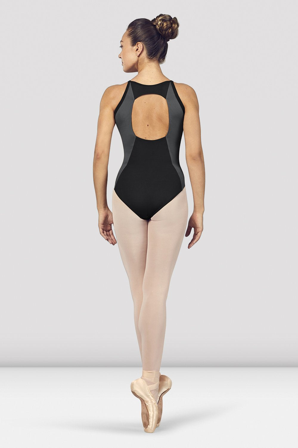 Black Bloch Ladies Naila Scoop Neck Open Back Camisole Leotard on female model en pointe in fifth position facing back