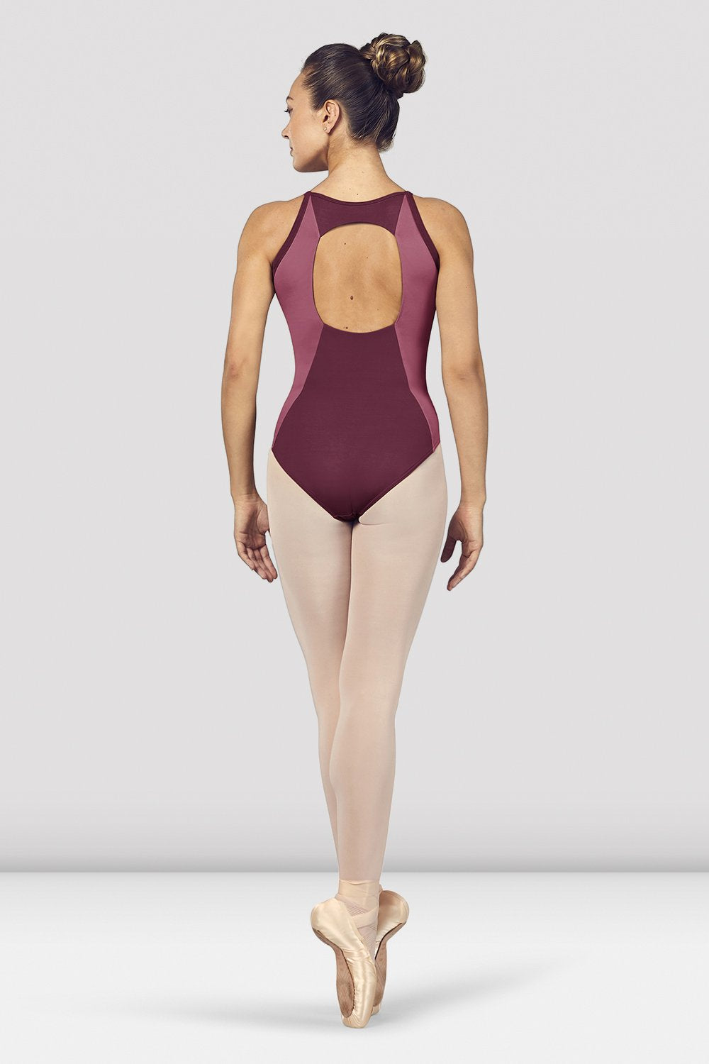 Dewberry Bloch Ladies Naila Scoop Neck Open Back Camisole Leotard on female model en pointe in fifth position facing back
