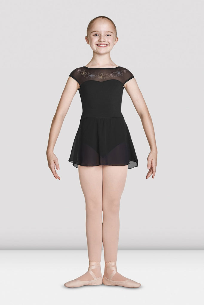 Black Bloch Girls Mesh Bodice Cap Sleeve Skirted Leotard on female model feet in first position with arms in demi bras