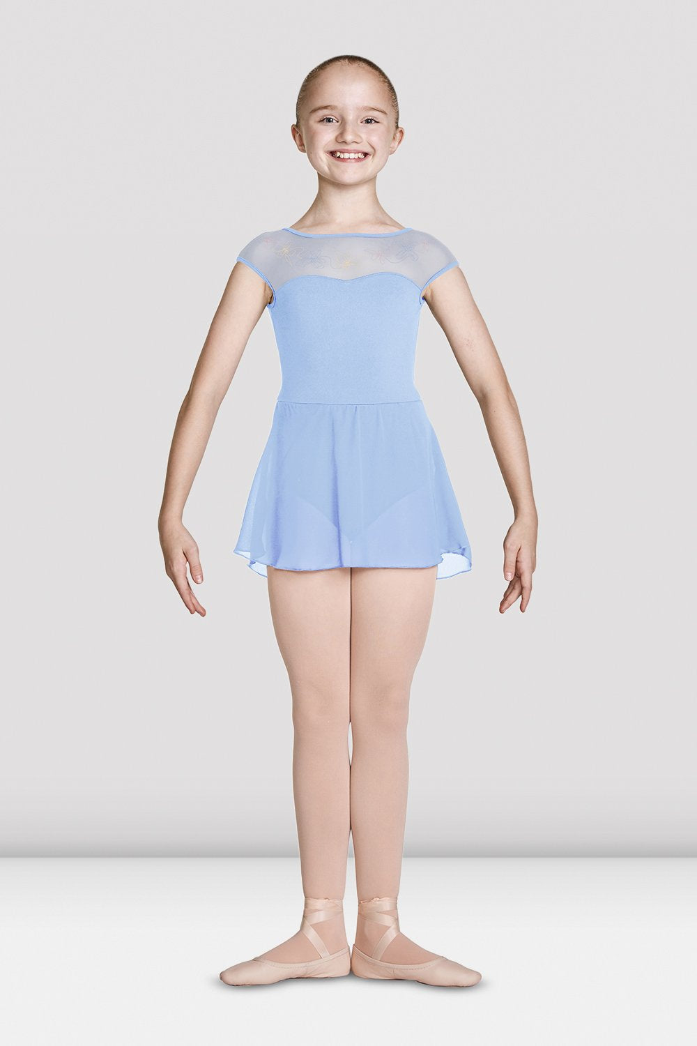 Blue Bloch Girls Mesh Bodice Cap Sleeve Skirted Leotard on female model feet in first position with arms in demi bras