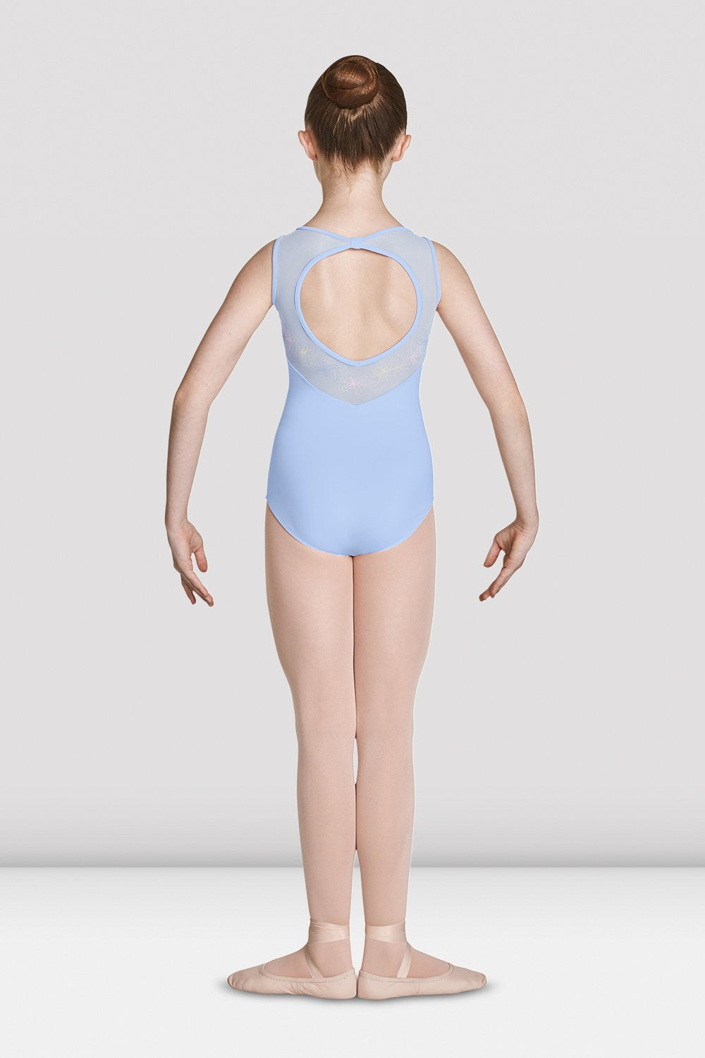 Pink Bloch Girls Open Back Sweetheart Tank Leotard on female model feet in first position with arms in demi bras facing the back