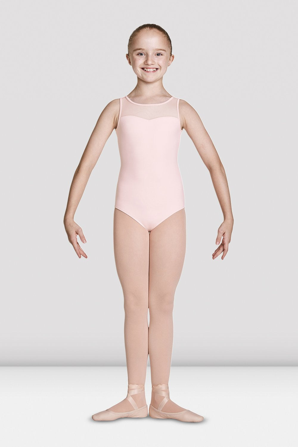 Pink Bloch Girls Open Back Sweetheart Tank Leotard on female model feet in first position with arms in demi bras