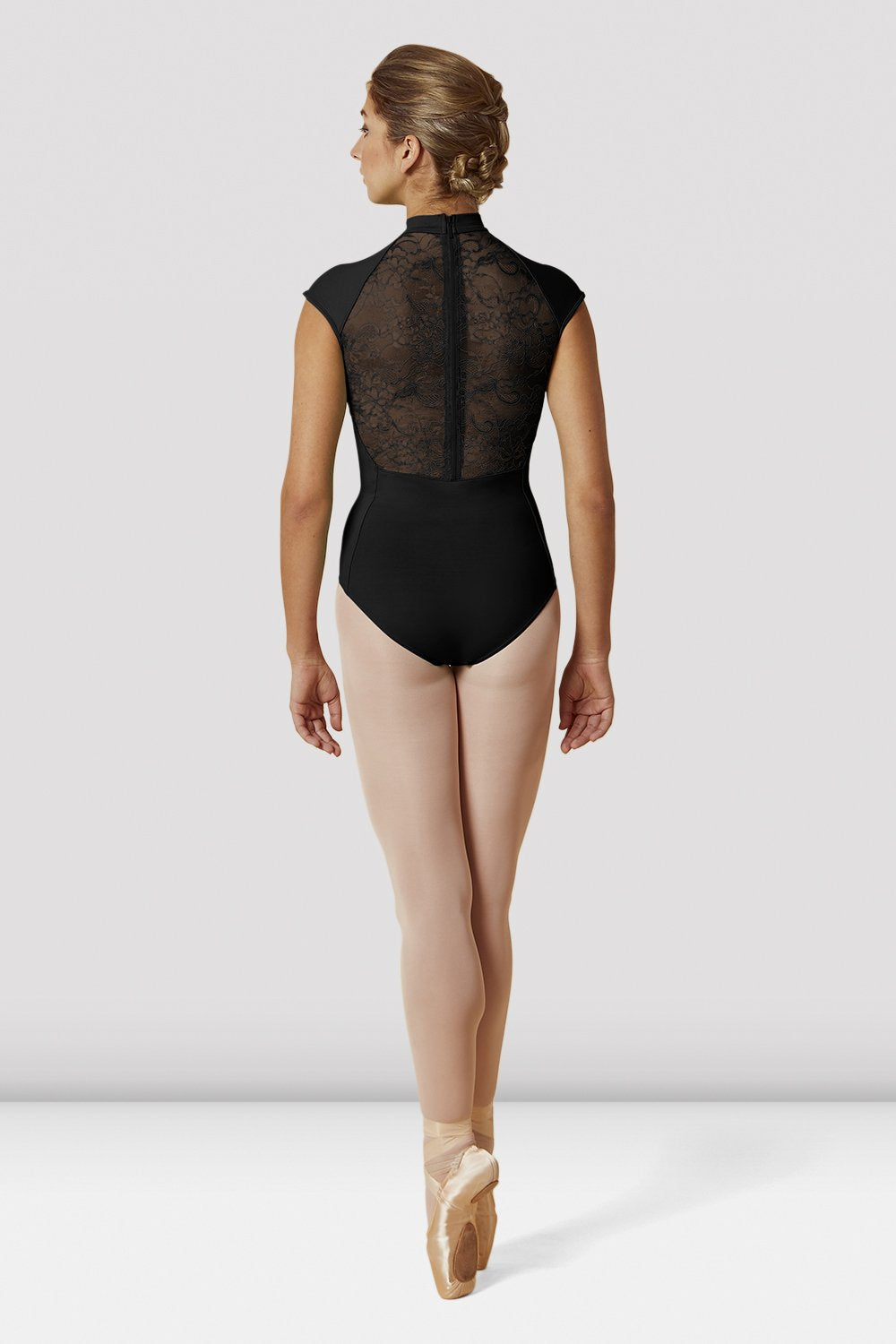 Black Bloch Ladies High Neckline Lace Mesh Zip Back Cap Sleeve Leotard on female model en pointe in fifth position facing back