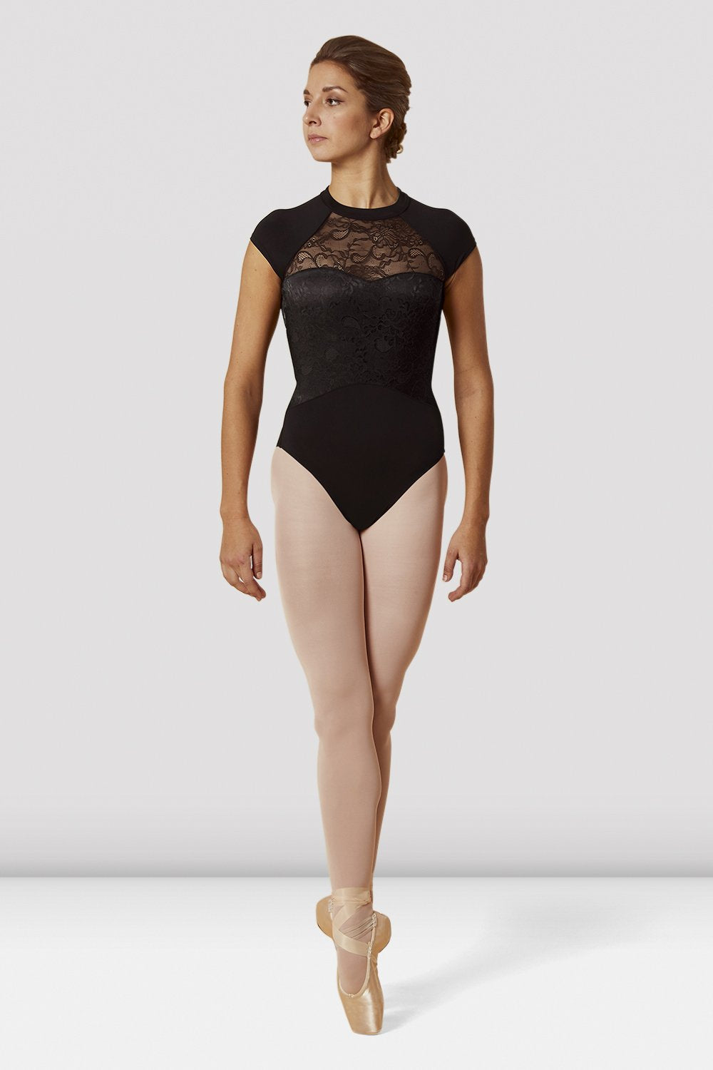 Black Bloch Ladies High Neckline Lace Open Back Cap Sleeve Leotard on female model en pointe in fifth position