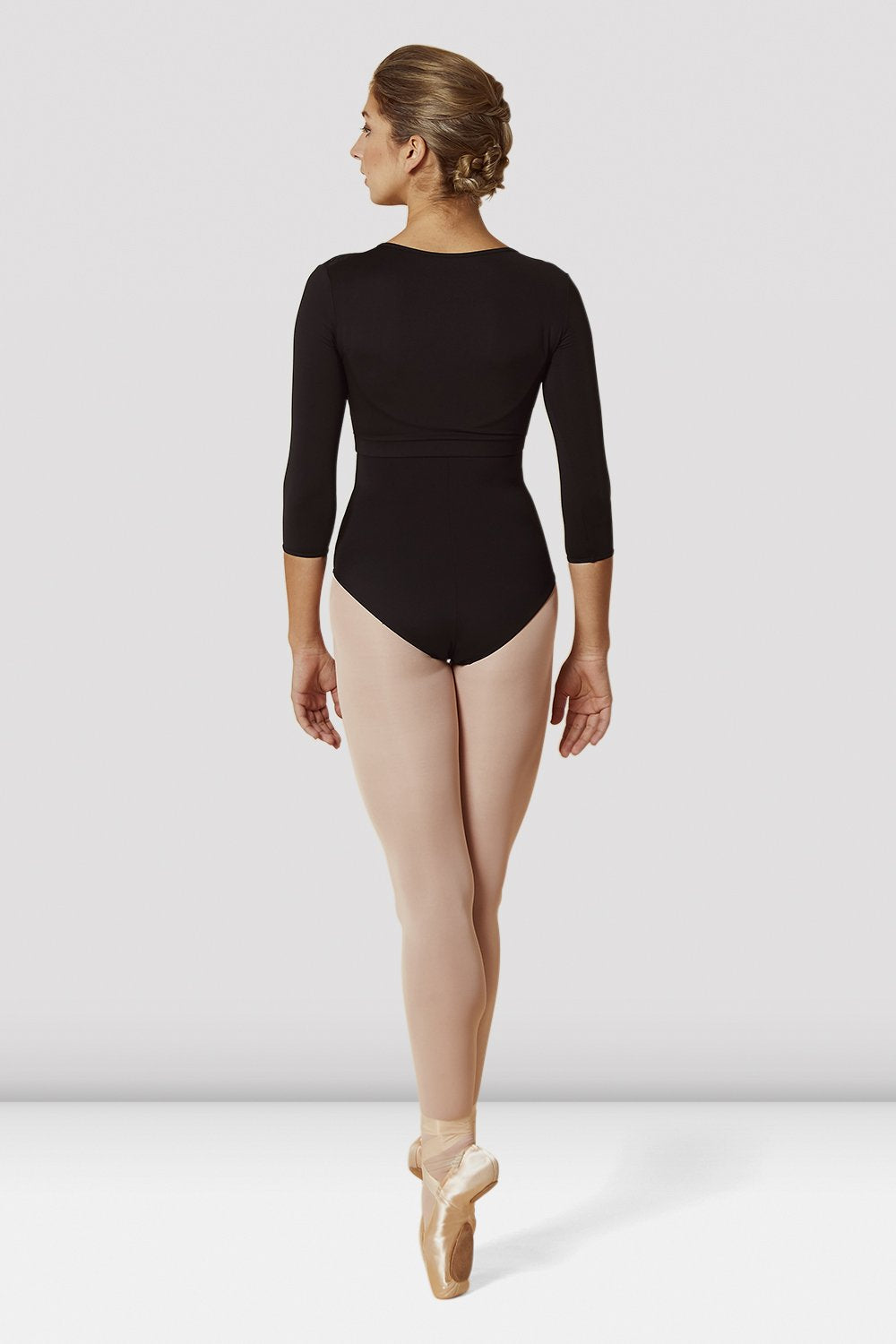 Black Bloch Ladies Lace Bodice Three Quarters Sleeve Wrap Top on female model en pointe in fifth position facing back