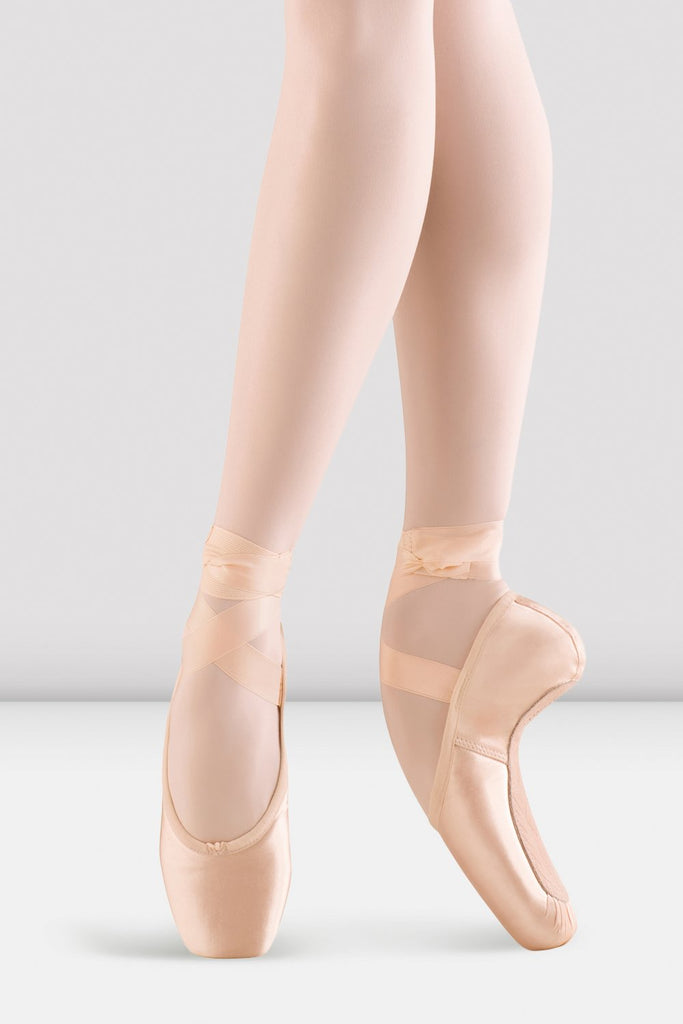 Pink satin Bloch Mirella Whisper Pointe Shoes on foot in fourth position en pointe