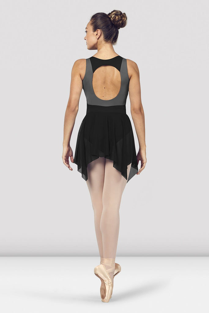 Black Bloch Ladies Fayre Uneven Hem Mesh Skirt on female model en point ein fifth position facing back