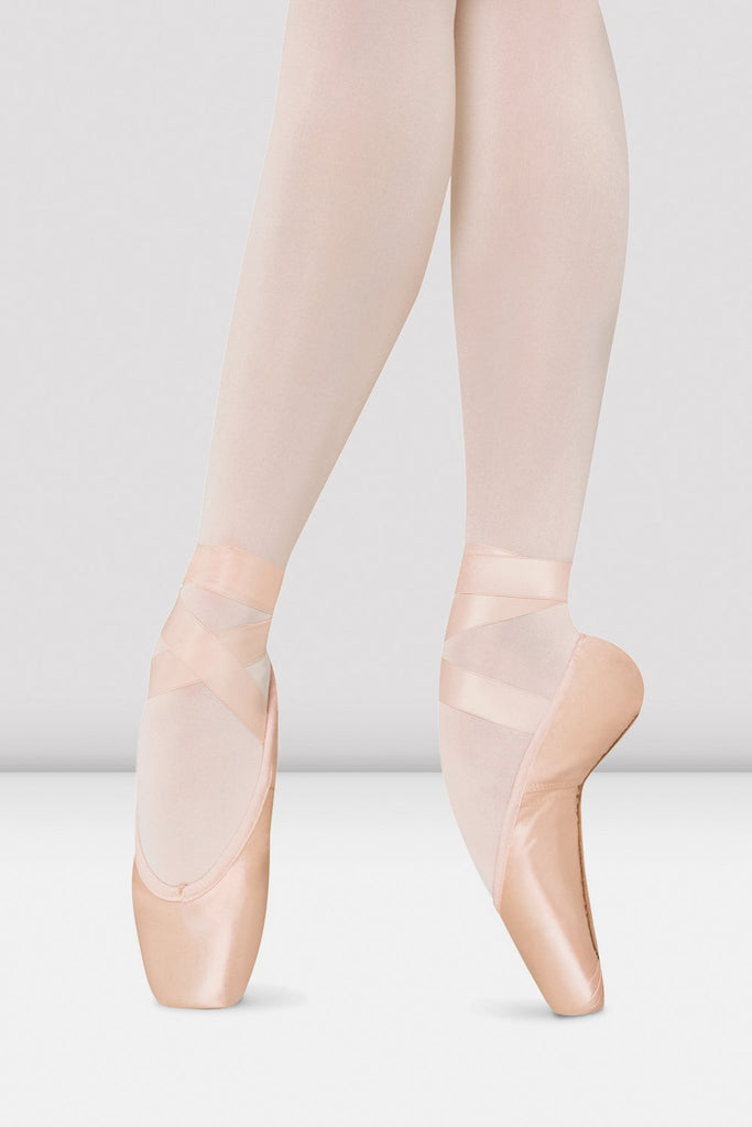 Pink satin Bloch Amelie Pointe Shoes on foot in fourth position en pointe