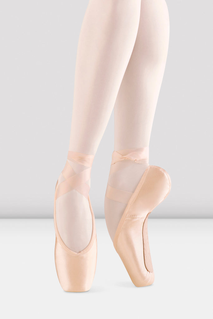 Pink satin Bloch Alpha Pointe Shoes on foot in fourth position en pointe