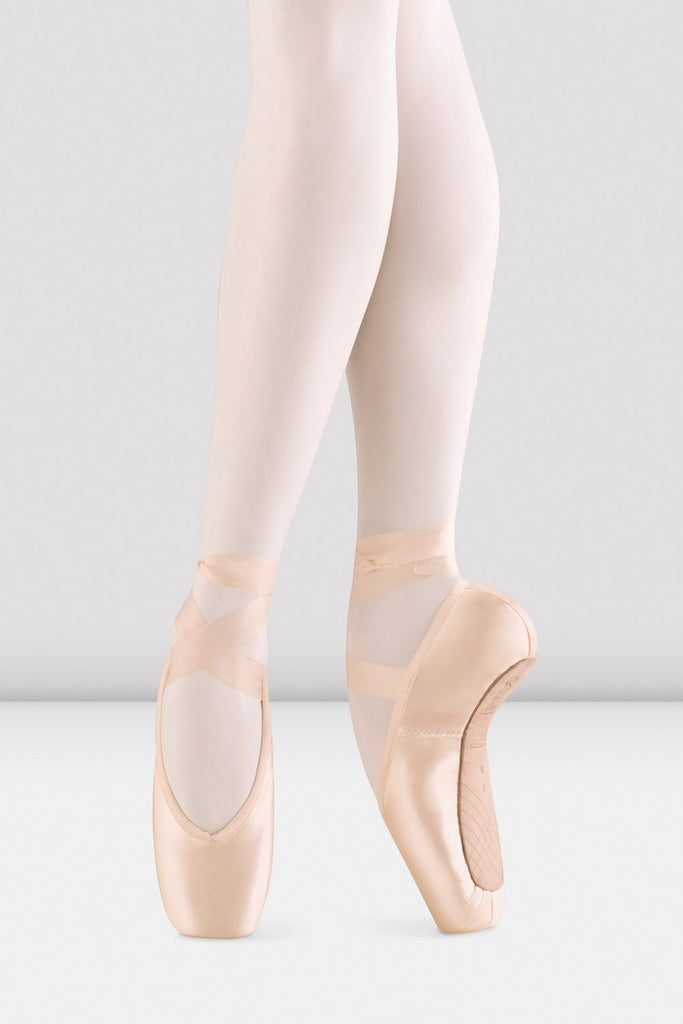 Pink satin Bloch Aspiration Pointe Shoes on foot in fourth position en pointe