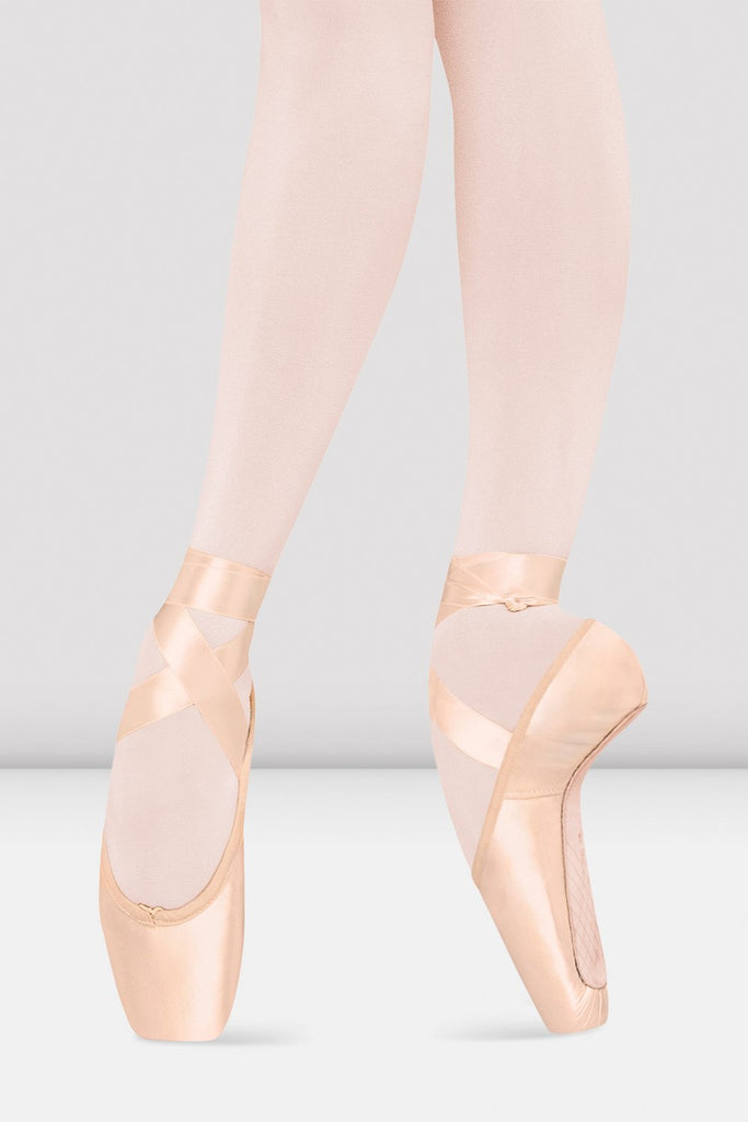 Pink satin Bloch Serenade Pointe Shoes on foot in fourth position en pointe