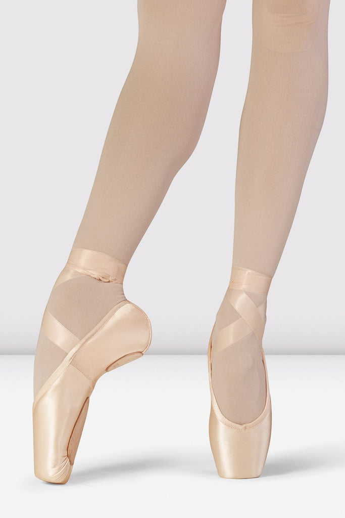 Pink Satin Bloch Superlative Stretch Pointe Shoes on foot in fourth position en pointe