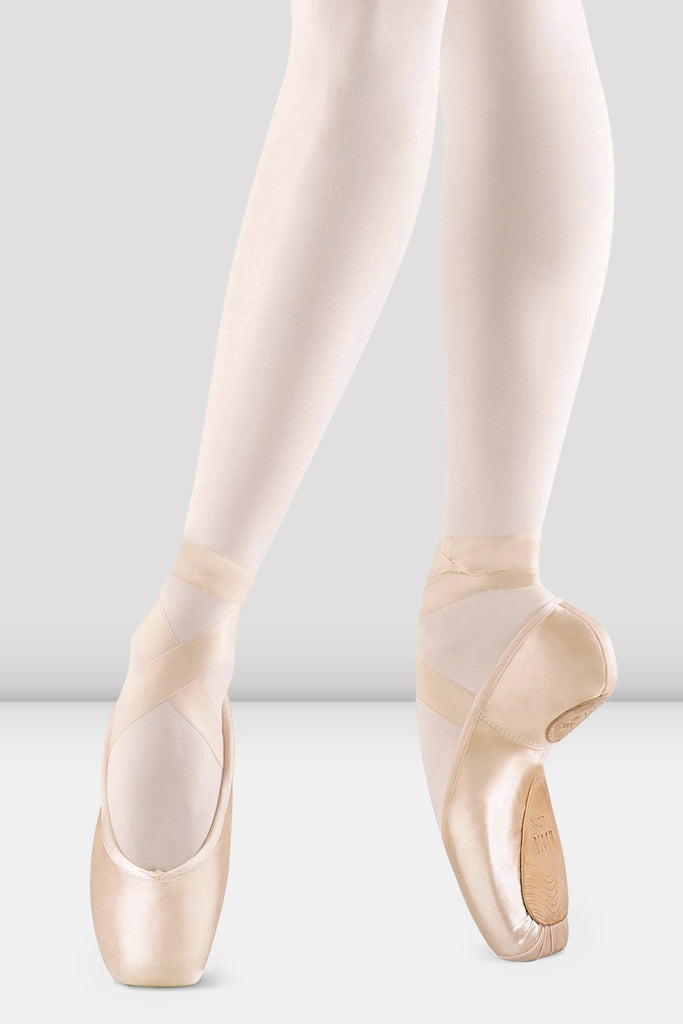 Pink Satin Bloch Axi Stretch Pointe Shoes on foot in fourth position en pointe