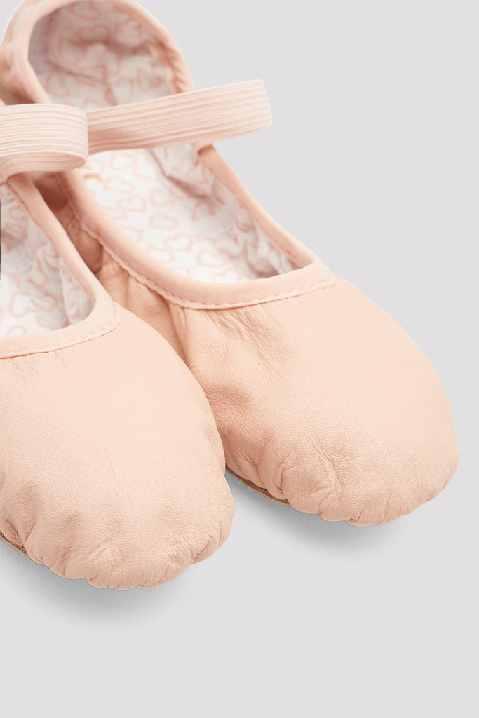 Theatrical pink leather Bloch Girls Belle Leather Ballet Shoes flatlay pair of shoes focus on the toe of shoes