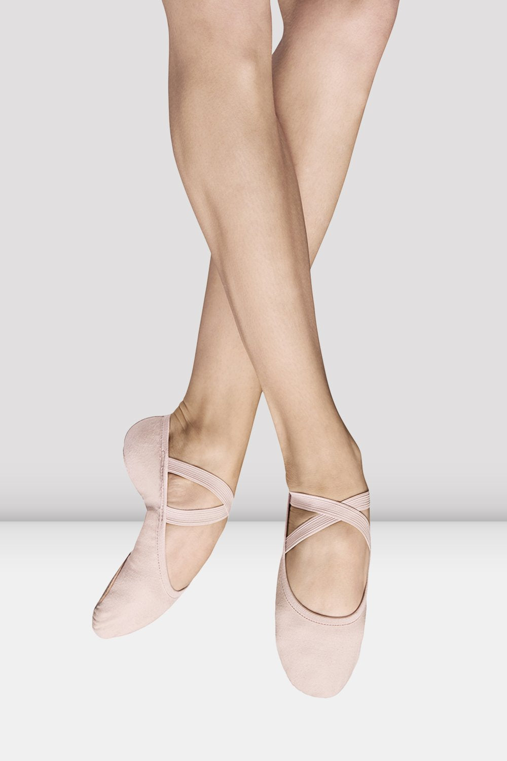 Theatrical pink canvas Bloch Ladies Performa Stretch Canvas Ballet Shoes pair of shoes on female foot jumping
